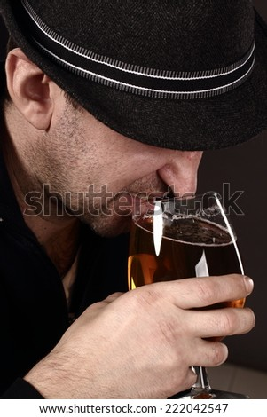 alcoholic in despair drinking beer, bad teeth, drunk man