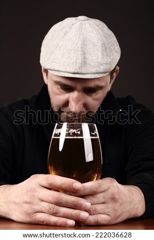 alcoholic in despair, smoker, beer  - stock photo