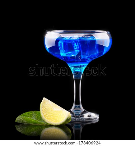 Alcoholic Nightclub Cocktails on a black party background - stock photo