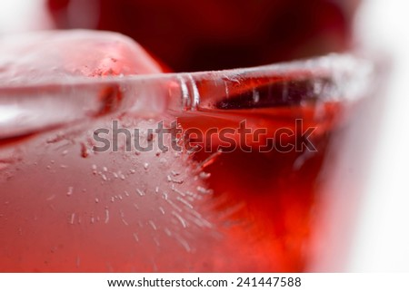 Alcoholic red cocktail with ice and pomegranate - stock photo