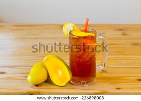 Alcoholic sweet tea with fruit similar to a long island iced tea at a Mexican restaurant bar. - stock photo