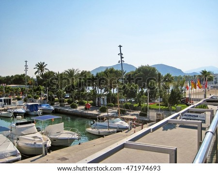 Alcudia, Majorca, Spain - June 26, 2008: Port of Alcudia - view from bridge towards promenade - boats and ships laying in harbor.
