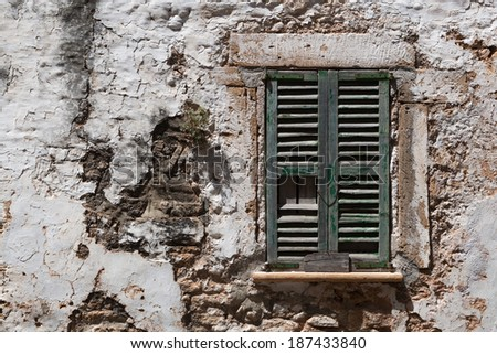 ALCUDIA, SPAIN - JULY 15, 2013: Shutters and wall in poor condition in Alcudia, Majorca.