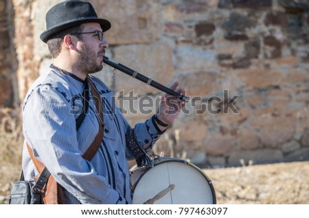 Alcuescar, Spain - December 17th, 2017: Traditional flute player and drummer from North Extremadura, Alcuescar, Spain