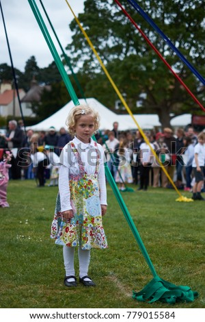 Aldborough, North Yorkshire United Kingdom - May 7 2017: At the annual May day event children dance around the May pole using ribbons in traditional dances to celebrate May Day