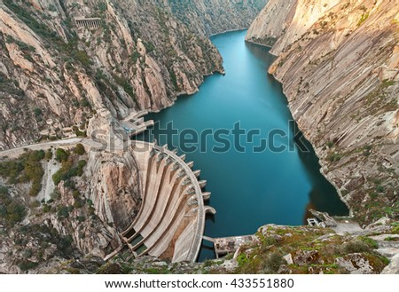Aldeadavila Dam is a concrete arch-gravity dam on the Douro River on the border between Spain and Portugal. - stock photo