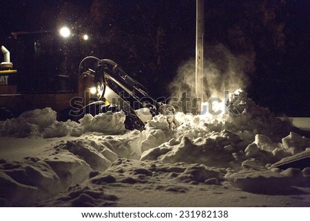 """Alden New York; 19 November 2014. A front end loader clearing some of the over five feet of snow that has fallen as part of the """"lake effect"""" snowstorm in Buffalo and Western New York.  - stock photo"""