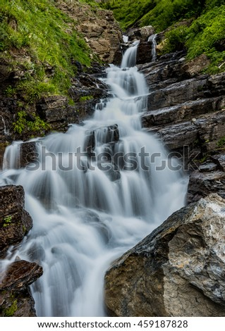 Alder Creek Falls tumbles over layered rocks
