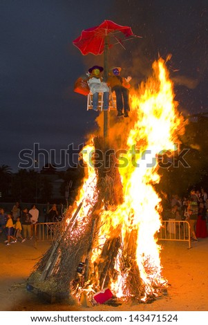 ALELLA, SPAIN  - JUNE 23: Bonfire during San Juan in Alella, Barcelona, Spain, on June 23, 2013. It is one of the most important holiday in Spain. The fire is the symbol of the festival.