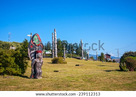ALERT BAY, CANADA - AUGUST 31, 2011: A totem pole at the Namgis Burial Grounds, one of the few remaining native cemeteries on the British Columbia coast where totems remain on their original site.
