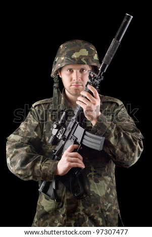 Alerted soldier raised m16 in studio. Upperhalf