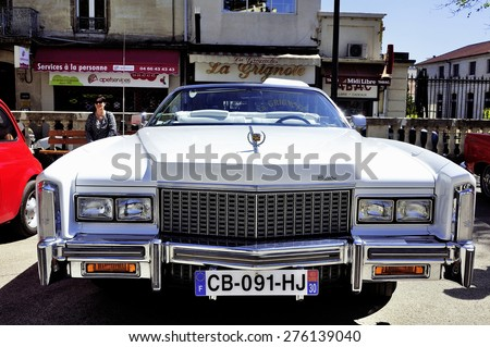 ALES, FRANCE - APRIL 11: before a white Cadillac Eldorado 1970 photographed at gathering old Town Hall Square cars in the city of Ales in the Gard department, April 11, 2015. - stock photo