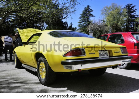 ALES, FRANCE - APRIL 11: Chevrolet Camaro yellow photographed vintage car rally in the city of Ales in the Gard department, April 11, 2015. - stock photo