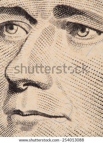 Alexander Hamilton face extreme macro on US 10 dollar bill, united states money closeup, 2013 series - stock photo