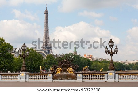 Alexander III bridge in Paris showing Eiffel tower behind on a sunny day - stock photo