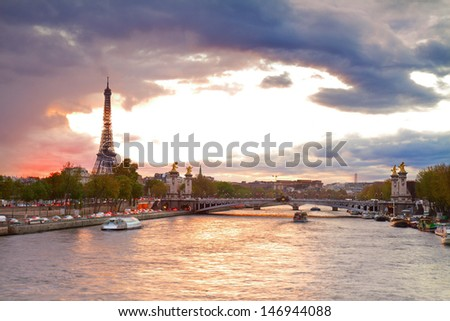 Alexandre III Bridge and Eiffel tower at sunset ,  Paris, France - stock photo