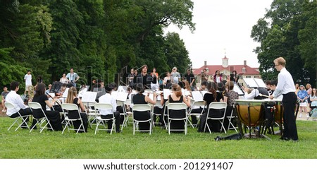 ALEXANDRIA, VA - AUGUST 3, 2013: Irvine Classical Players Seraphim Symphony, on tour from Irvine, CA., performed for crowds of tourists at George Washington's Mount Vernon in front of the Mansion.