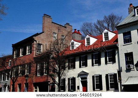 Alexandria, Virginia - April 13, 2014:  18-19th century Federal era houses on Cameron Street in Old Town