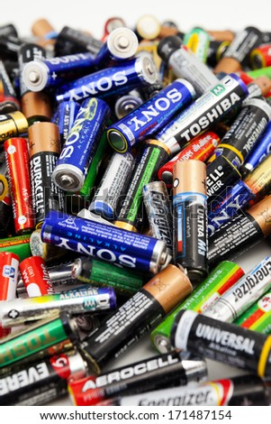 ALEXANROUPOLI, GREECE - NOVEMBER 14: Different types of used batteries ready for recycling on November 14, 2013, Types are AAA, AA, - stock photo