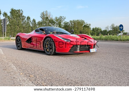 "ALFONSINE, RA, ITALY - MAY 14: crew on a supercar La Ferrari in ""Ferrari tribute to Mille Miglia"" during the italian historic race 1000 Miglia on May 14, 2015 in Alfonsine, Ravenna, Italy"