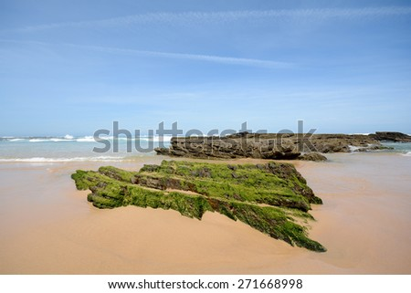 Algarve: Beach Praia da Arrifana, Coastline with rocks at low tide - Atlantic ocean Portugal Europe - stock photo
