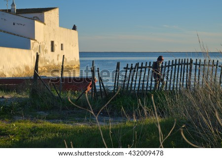ALGARVE, PORTUGAL - January 24, 2015: Scene near a mill House in Ria Formosa, Olhao. Travel and vacation destinations - stock photo