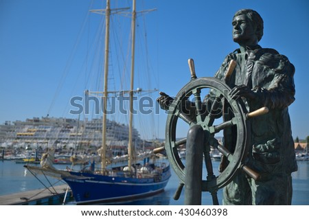 ALGARVE, PORTUGAL - July 12, 2015: Vilamoura Marina's sailor statue. Travel and summer vacation destinations - stock photo