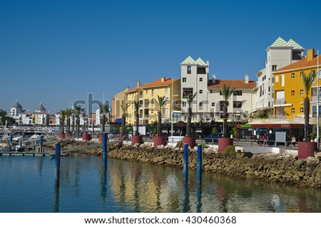 ALGARVE, PORTUGAL - July 12, 2015: Vilamoura Marina, yachts and hotel buildings. Travel and summer vacation destinations