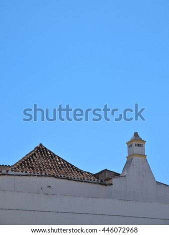 ALGARVE, PORTUGAL - June 25, 2016: Typical chimney from the Algarve region. Travel and vacation destinations - stock photo