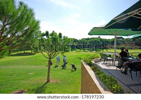 ALGARVE, PORTUGAL - OCTOBER 2, 2009: Landscape with golf course and golf club terrace cafe in Algarve, Portugal - stock photo