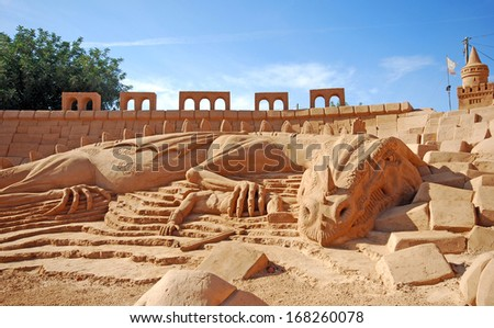 ALGARVE, PORTUGAL-OCTOBER 3:large sand fantastic dragon sculpture of unidentified artist at FIESA, International Sand Sculpture Festival in Algarve, Portugal on October 3, 2009.    - stock photo