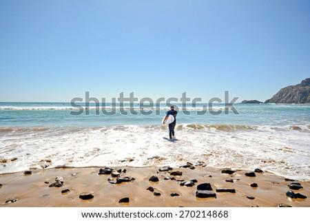 Algarve: Surfer beach Praia da Arrifana near Aljezur, Portugal  - stock photo