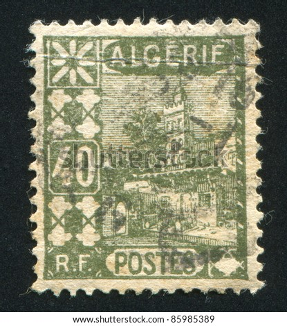 ALGERIA CIRCA 1927: A stamp printed by Algeria, shows Mosque of Sidi Abd-er-Rahman, circa 1927