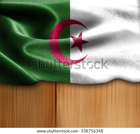 Algeria flag on wood Texture