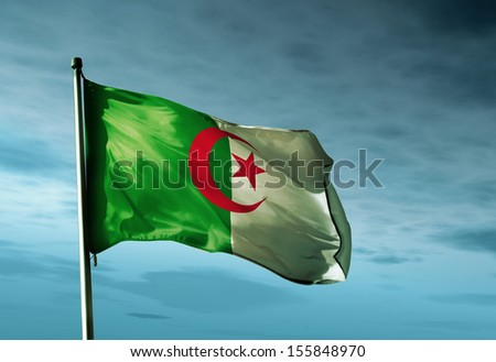 Algeria flag waving in the evening - stock photo