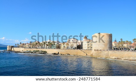 Alghero coastline under a clear sky. Shot in Sardinia, Italy - stock photo
