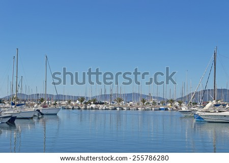 Alghero harbor on a clear winter day - stock photo