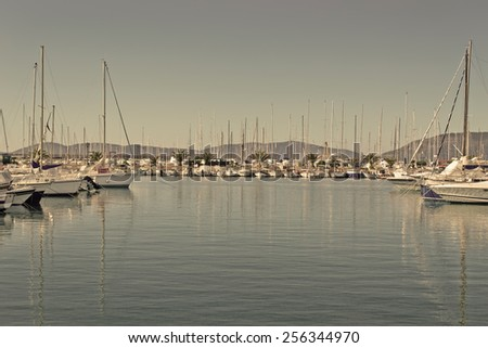 Alghero harbor on a clear winter day in vintage tone - stock photo