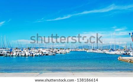 Alghero harbor on a sunny day - stock photo