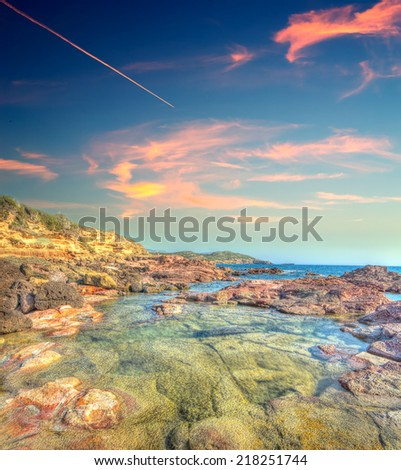 Alghero rocky shore in hdr tone mapping - stock photo