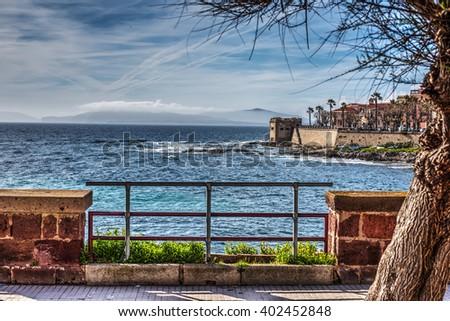 Alghero seafront under a cloudy sky, Italy - stock photo