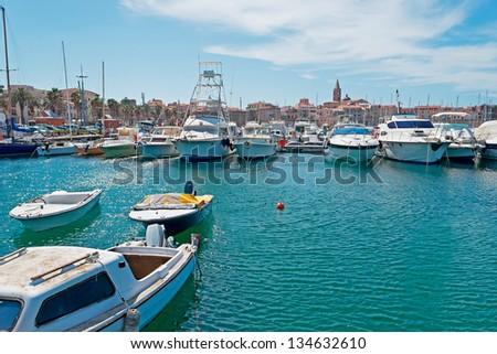 Alghero seen from the harbor - stock photo
