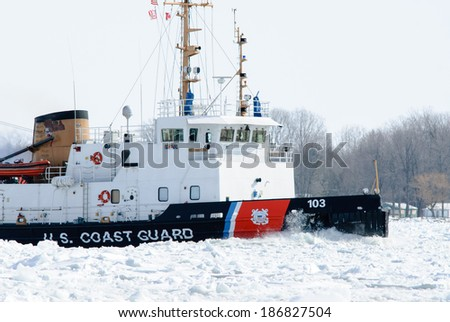 ALGONAC, MI - USA - FEBRUARY 24, 2010: The USCG MOBILE BAY on February 24, 2010 working ice at Algonac, MI on the St Clair River. The MOBILE BAY is a 140' tug with ice breaking capabilities.