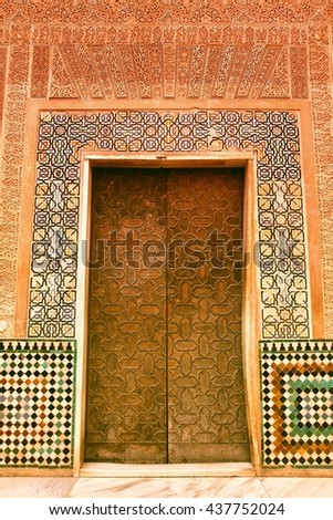 Alhambra castle, Nasrid palace door. Granada in Andalusia region of Spain. UNESCO World Heritage Site. Filtered retro color style. - stock photo