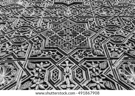 Alhambra in Granada, Spain. Detail of a 800 years old wall in islamic style.