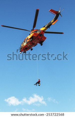 ALICANTE COAST, SPAIN - FEBRUARY 15. Search and rescue maneuvers by the Spanish army helicopter at a conference of Emergency and Public Safety in Altea, Spain, on February 15, 2015 - stock photo