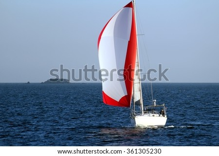 ALICANTE COAST, SPAIN - JANUARY 04: The sailboat CHAMACO goes along the coast of Alicante, on january 04, 2016 in Alicante.