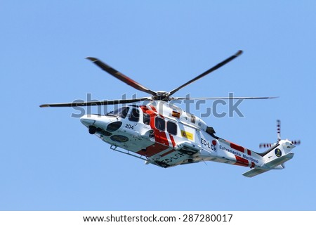 ALICANTE COAST, SPAIN - JUNE 14: Helicopter of the Spanish  Maritime Rescue Team finding injured over Cabo La Nao beach, on june 14, 2015 in Alicante coast.