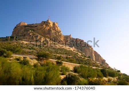 Alicante Santa Barbara Castle in Spain high up the mountain near Mediterranean sea - stock photo