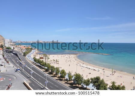 "ALICANTE, SPAIN - APR 8: El Postiguet Beach (named after the secondary gate (""postigo"" in Spanish) that gave access to the town) is located in downtown Alicante Apr 8, 2012."